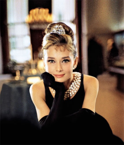 Audrey Hepburn in Breakfast at Tiffany 39s wearing pearl strands and a